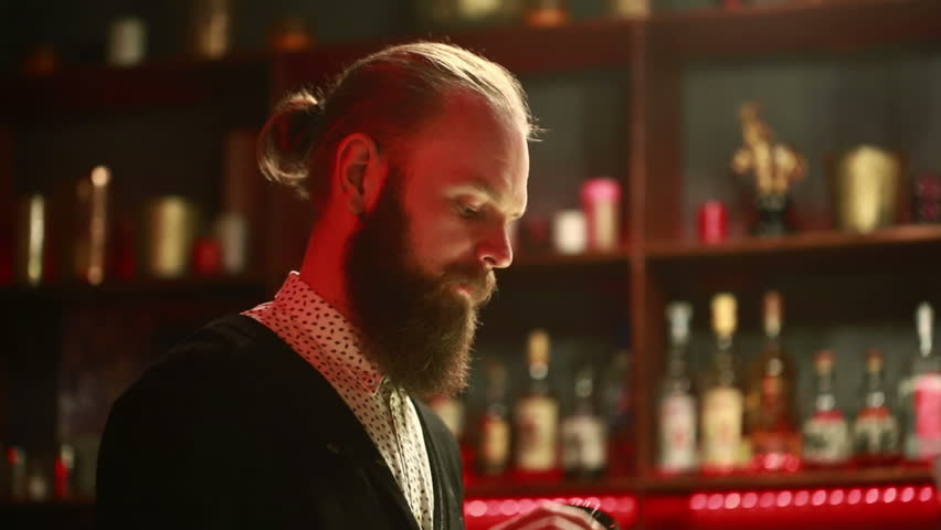 Handsome barman professional at posh bar making cocktail drinks | Shutterstock HD Video #15359716