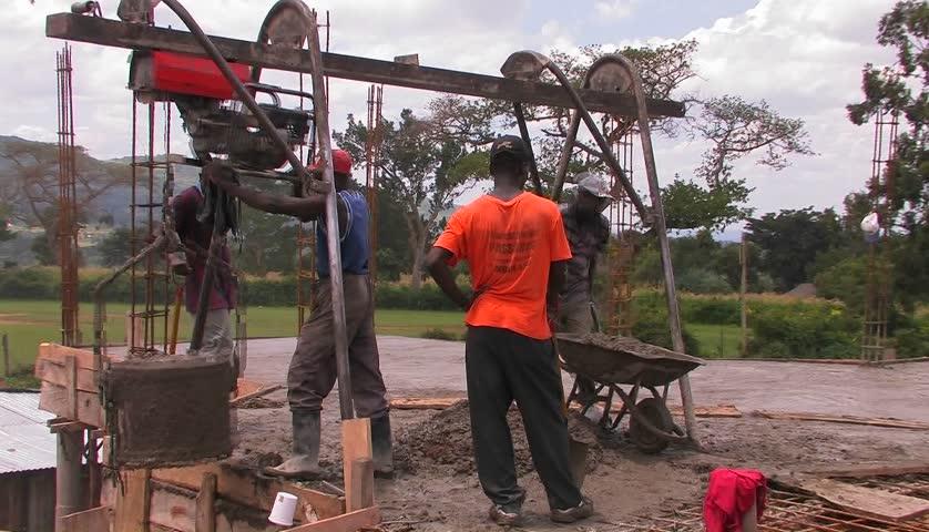 KENYA, AFRICA - CIRCA 2009: Men on a construction site do cement work circa 2009 in Kenya. - HD stock video clip