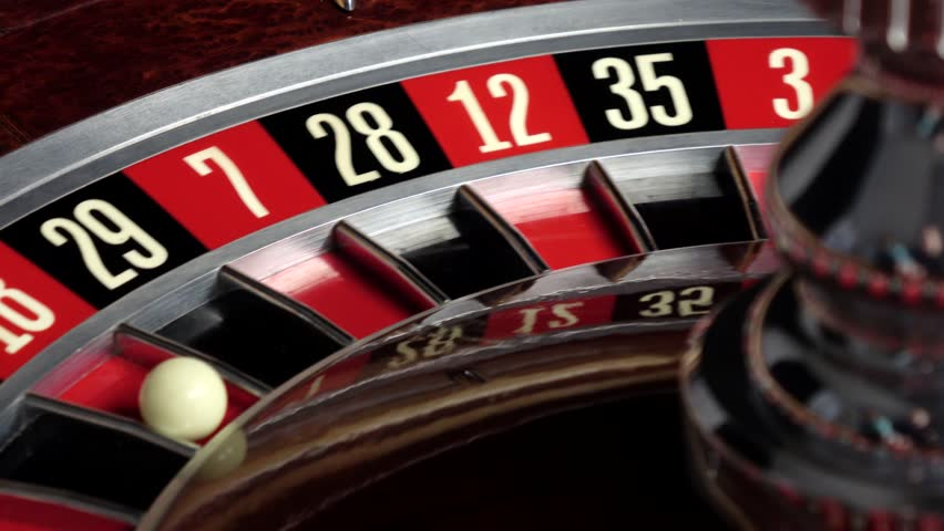 Roulette wheel starts running and stops with white ball | Shutterstock HD Video #15408568