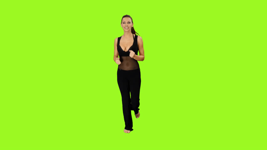 Young athletic woman is jogging on a green screen background, Front view, Full HD footage with alpha channel - HD stock video clip