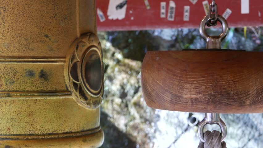 KYOTO, JAPAN -NOV 24, 2015: The old large bronze bell and swaying hitting log in the bell tower of Otagi Nenbutsu-ji temple in Kyoto, Japan.  - 4K stock video clip
