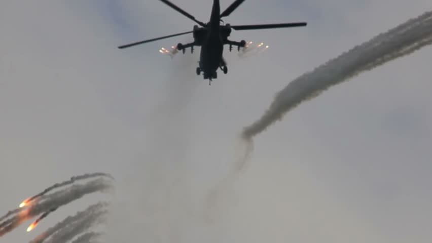 Military helicopter classified as HAVOC in blue sky