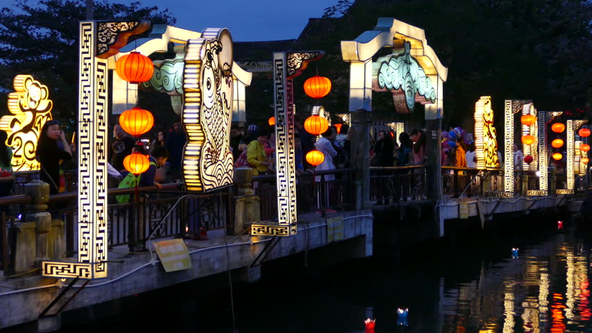 The Cau An Hoi bridge in the evening with Floating lanterns in the water in Hoi An Vietnam | Shutterstock HD Video #15596920