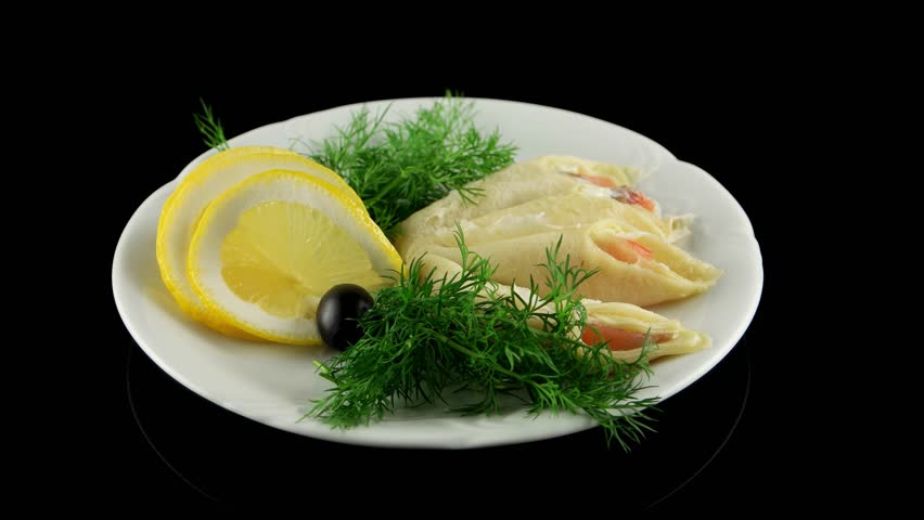 Pancakes with smoked salmon and butter, loop, horizontal view - 4K stock footage clip