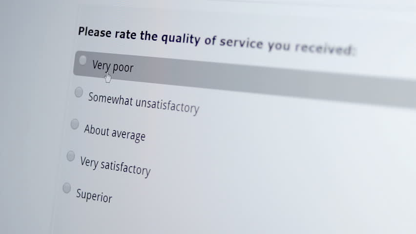 Macro shot of a mouse cursor on a monitor indicating a person giving an unsatisfactory service review on a computer based internet business customer satisfaction survey.