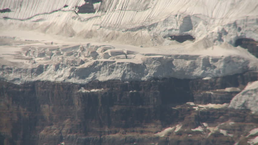Zoom out of mountains to reveal Lake Louise