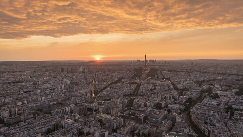 Sunset above Paris with dramatic sky and Eiffel Tower on horizon, France. Time Lapse | Shutterstock HD Video #15650092