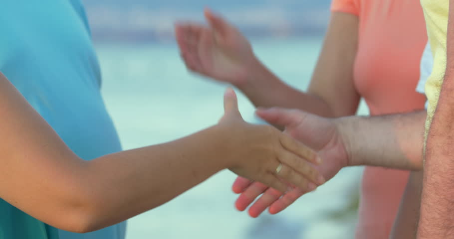 Group of undefined people is shaking hands of each other. | Shutterstock HD Video #15671179