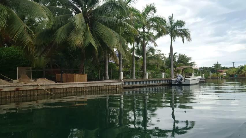 Placencia, Belize - March, 2016 - Sailing through Mango Creek in Placencia.