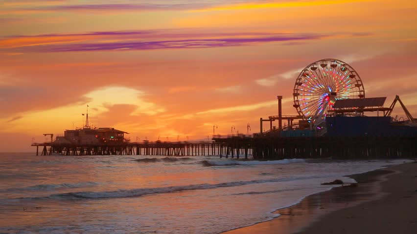 Santa Monica California sunset on Pier Ferris wheel and reflection on beach wet sand - HD stock video clip