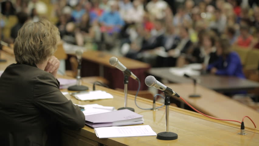 A state senator listens to testimony at the Massachusetts State House  | Shutterstock HD Video #15721012