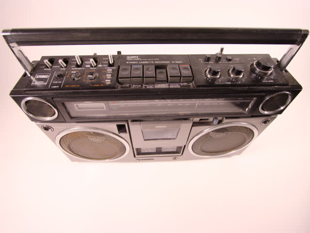 ghetto blaster spits out cassette tape - SD stock footage clip