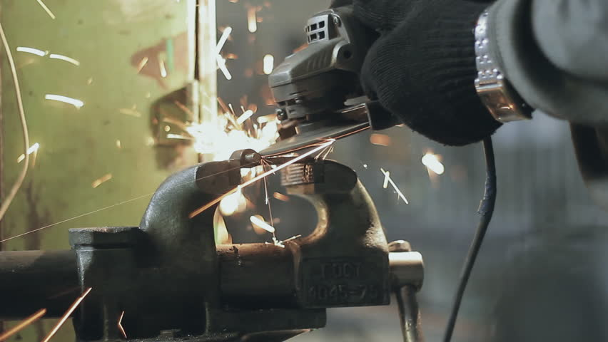 Worker Grinder cleans metal | Shutterstock HD Video #15774553