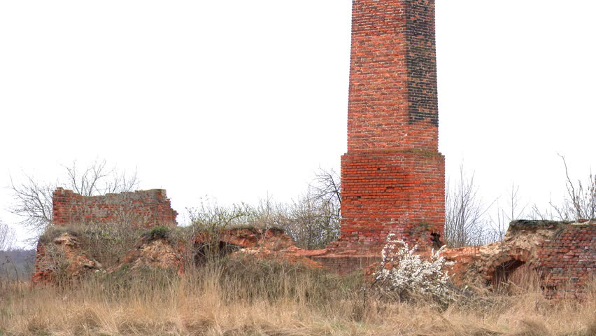 Ruins of an old, abandoned brickyard. 4K camera pan. - 4K stock footage clip