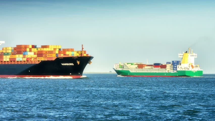 Container ships with full of cargo crossing in North sea. September 2015, Holland   Shutterstock HD Video #15812695