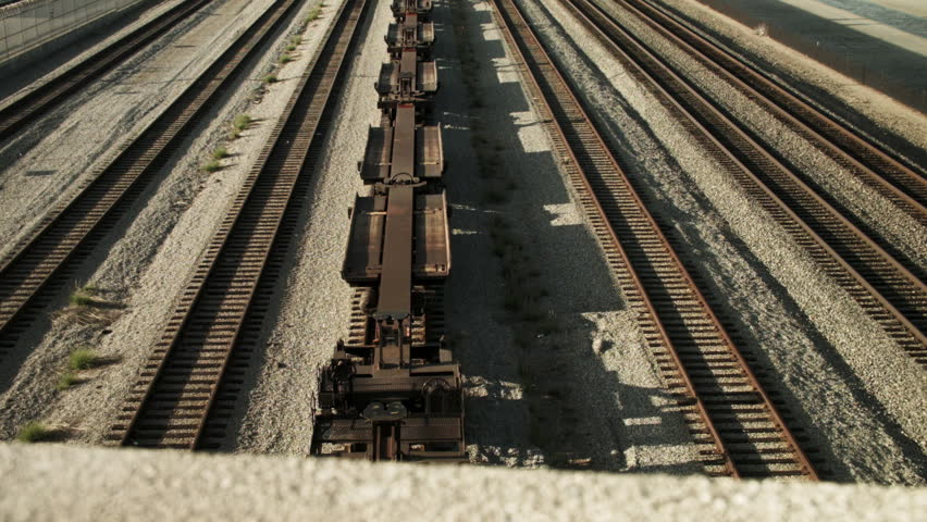 Train tracks extend to the horizon in the industrial area south of Los Angeles. | Shutterstock HD Video #15827437