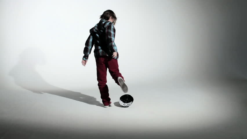 November 26, 2010: Boy kicking baseball cap and putting it on - HD stock video clip