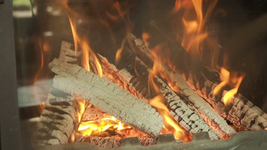 A man warming his hands by a fireplace. - HD stock video clip