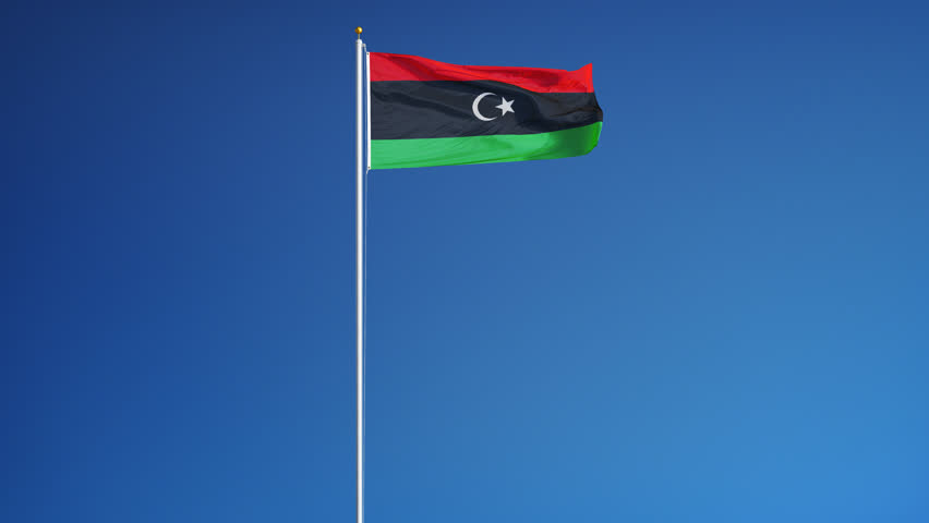 Libya flag waving in slow motion against clean blue sky, seamlessly looped, long shot, isolated on alpha channel with black and white luminance matte, perfect for film, news, digital composition - 4K stock footage clip