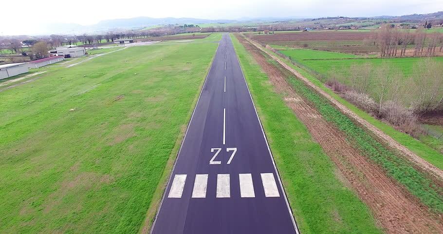 Pov of plane landing in airport on runway aerial shot
