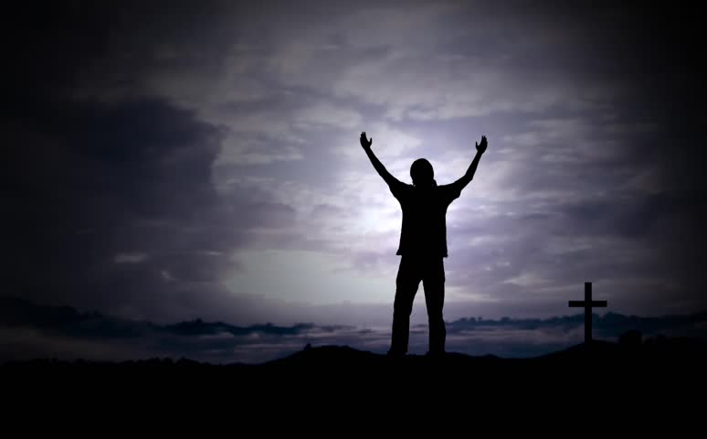 Man Holds hands up to Worship, cross in the background. - HD stock footage clip
