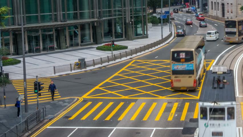 HONG KONG/HONGKONG - MAR 31 2016: Timelapse of City Traffic and Pedestrian at Hong Kong Central Distict | Shutterstock HD Video #16008841