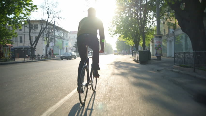 Man riding a bicycle on the empty road slow motion | Shutterstock HD Video #16020001