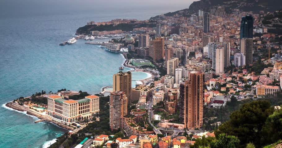 Monaco, Monte-Carlo, 05 april 2016: Timelapse shoot of Monte-Carlo aerial view, night lights, night city, port Hercule, Prince Palace of Monaco, mountain, skyscrapers, zoom effect, mediterranean sea | Shutterstock HD Video #16027696