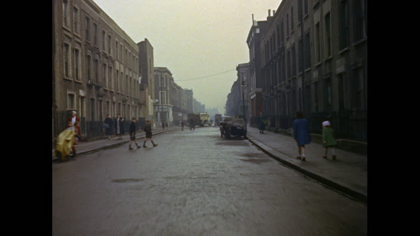 West London street scenes with terraced housing and vintage cars circa 1960, scanned from 35mm film. UK, 1960s   Shutterstock HD Video #16029415