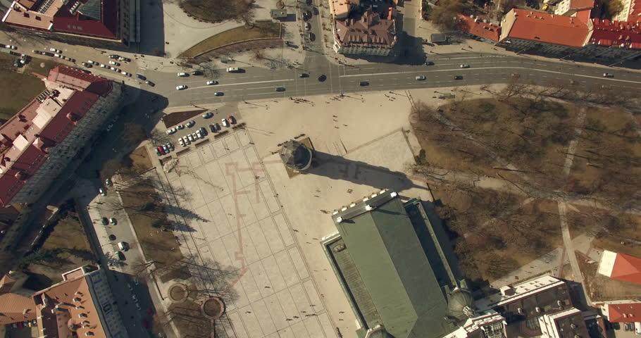 AERIAL. 360 degree spin above Cathedral of Vilnius, Lithuania. Sun clock arrow