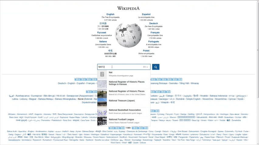 VILNIUS, LITHUANIA - APRIL 21, 2016: Searching wikipedia website for information about NATO on April 21, 2016 in Vilnius, Lithuania.