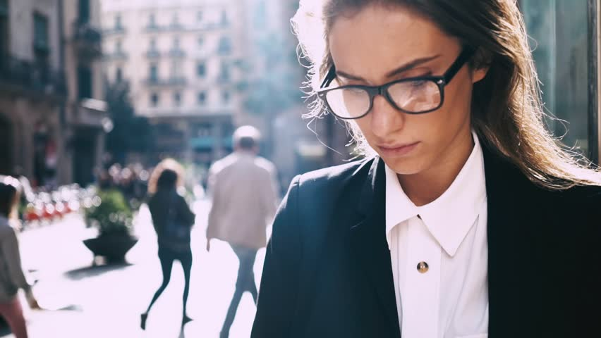 Close-up of young professional businesswoman using smartphone and drinking coffee to go outdoors, sunlight, slow motion | Shutterstock HD Video #16045867