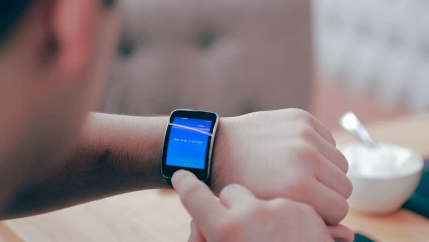 Smartwatch on a mans hand.
