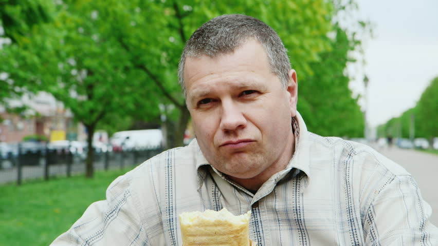 Portrait of a very hungry man eating junk food | Shutterstock HD Video #16141627