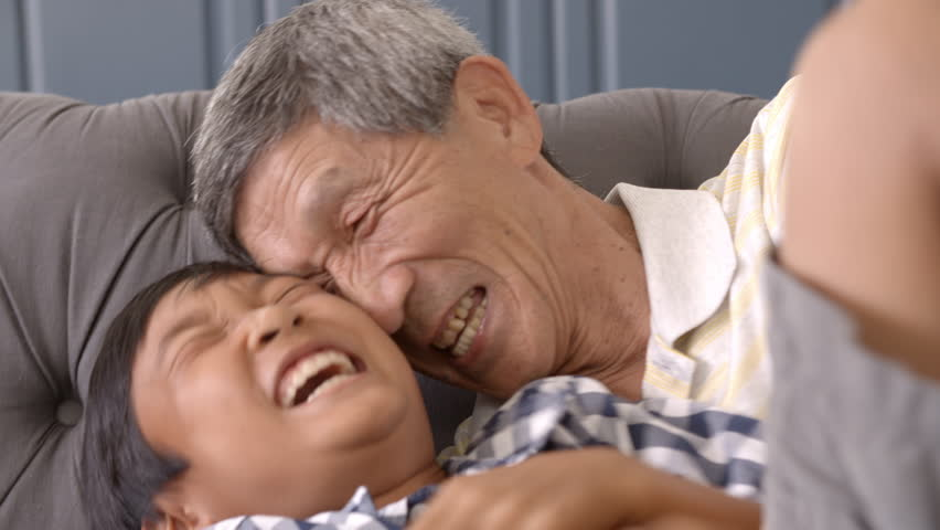 Slow Motion Shot Of Grandfather And Grandson Laughing