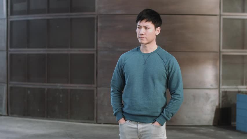 Portrait of Asian Male in city