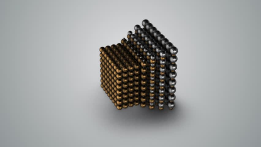 Metal cube made from spheres collapsing from chrome to gold, animation loop.