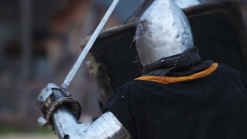 Battle between two aggressive and strong opponents, medieval knights. Slowmotion