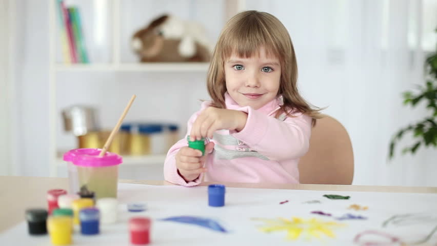 Girl drawing a green paint  - HD stock video clip