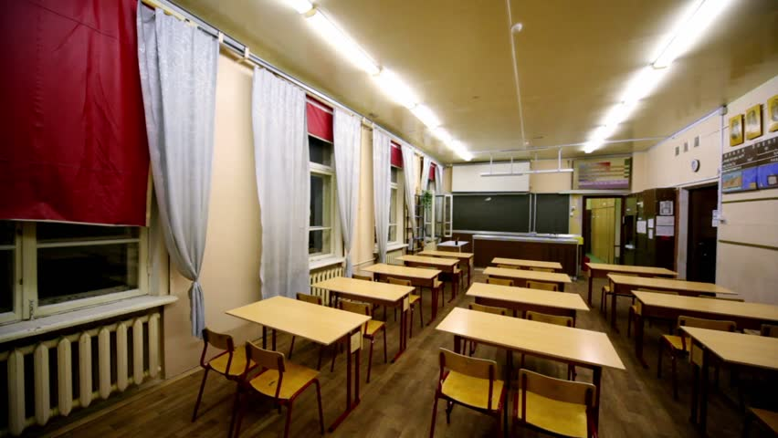 Rows of chairs and tables inside empty physics school class, panoramic view from behind - HD stock footage clip