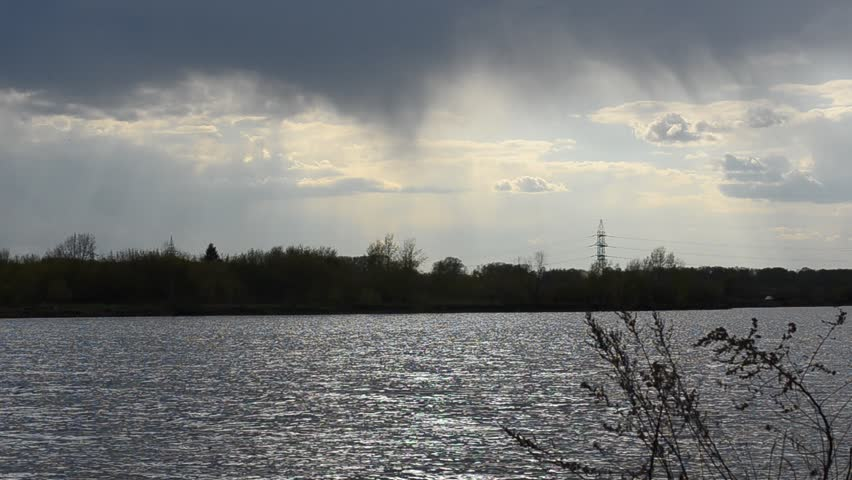 The shore of the lake against a stormy sky. #16311718