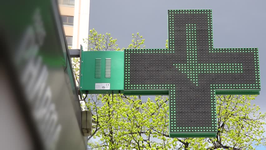 LED Pharmacy Sign Green Cross Board Time Lapse. The green cross is internationally recognised as the universal symbol of the pharmacy. LED sign is a very effective communication and advertising tool. | Shutterstock HD Video #16322140