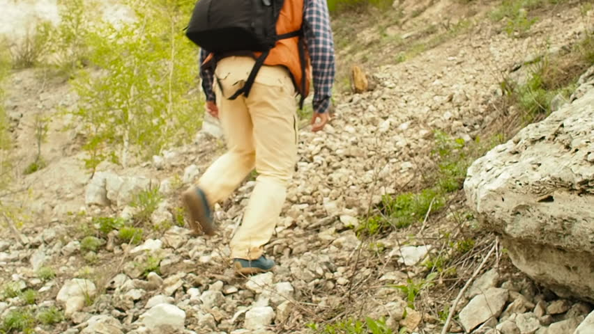 Man hikes uphill, Makes It To the top, adventure to nature