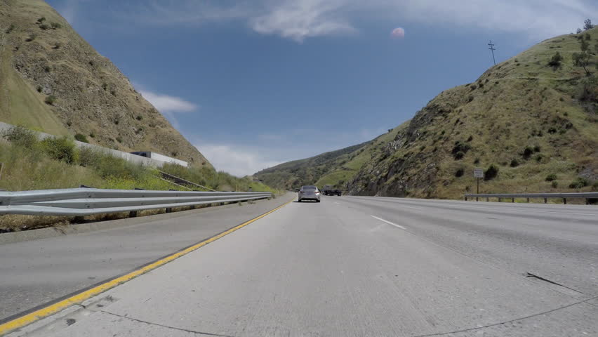 Frazier Park, California, USA - April 26, 2016:  Driving time lapse on the Golden State 5 freeway Tejon Pass near Los Angeles. - 4K stock video clip