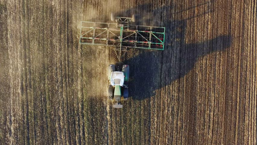 The tractor sows the field. Top view appears in the frame | Shutterstock HD Video #16363810