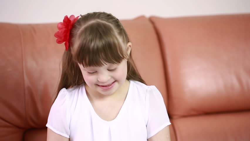 Emotions of a little girl with Down syndrome. disabled girl laughs | Shutterstock HD Video #16413166