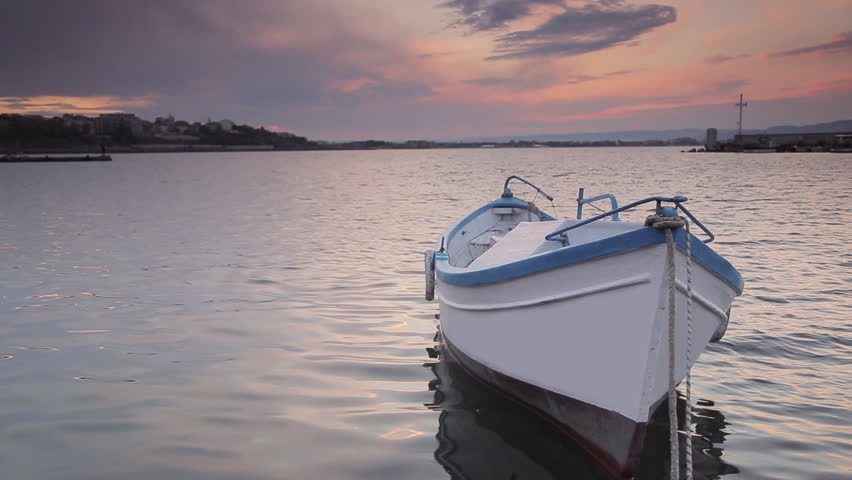 Fishing boat at sunset calm water - HD stock video clip