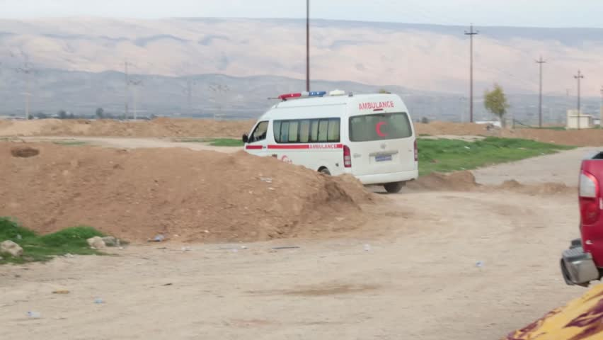 Iraq, February 2016: Iraqi ambulance driving away from the Kurdish frontline