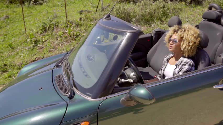 Young Black Sexy Lady Driving The Car - HD stock footage clip
