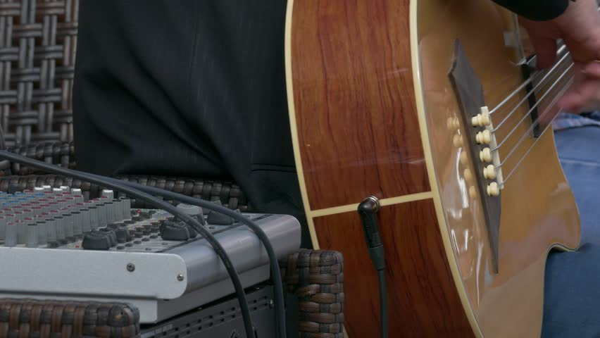 Ungraded: Bassist Playing / Bass Player / Street Musician. Bassist playing acoustic bass at rock concert. Hand close-up. Source: Lumix DMC, ungraded H.264 from camera without re-encoding. (av25283u) - 4K stock footage clip